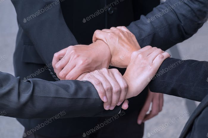 Four hands holding together