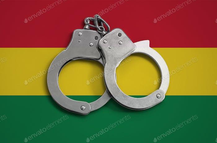 Bolivia flag  and police handcuffs