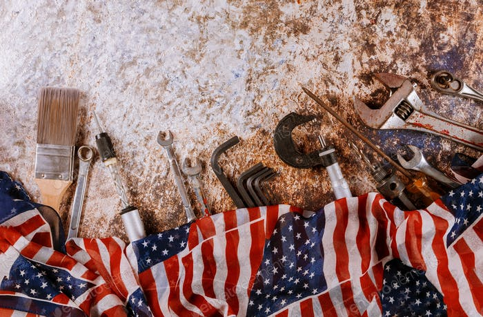 Wrench constructor tools on a United States of America flag in Labor Day is a federal holiday with
