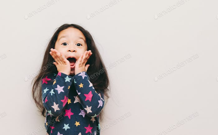Diverse girl looking very surprised and happy