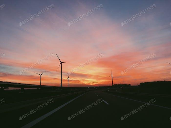 Windfarm windmills in Europe against sunset