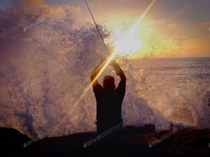 This fisherman was startled by the huge wave