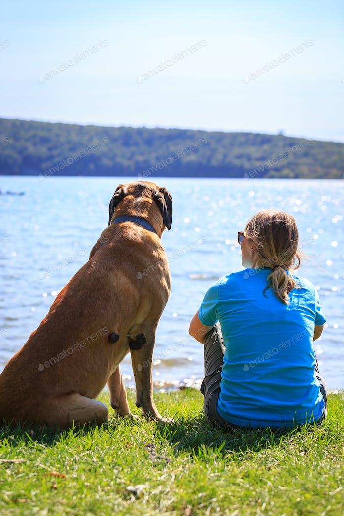 Mastiff and Woman Enjoying Spring