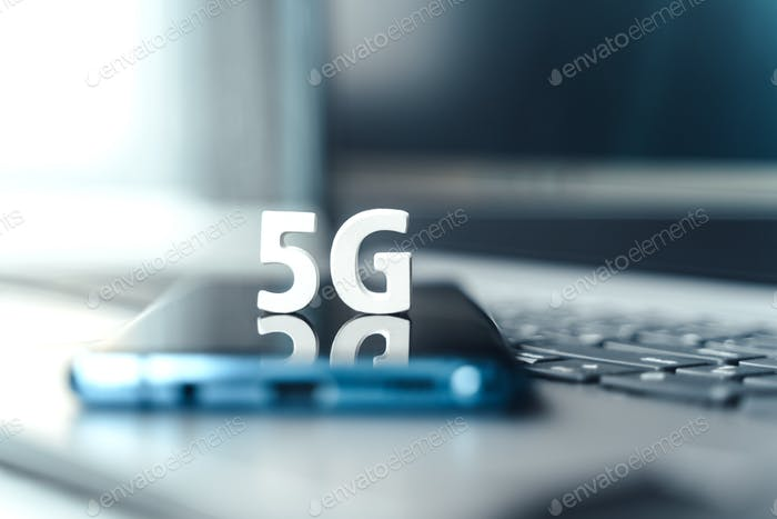 Mobile phone,smartphone with 5 G wireless high speed internet.Creative letters 5G on touch screren