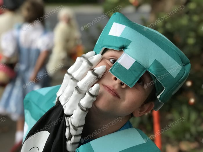 Armored Minecraft Steve with the Grim Reaper's hand on his face while trick-or-treating on Halloween