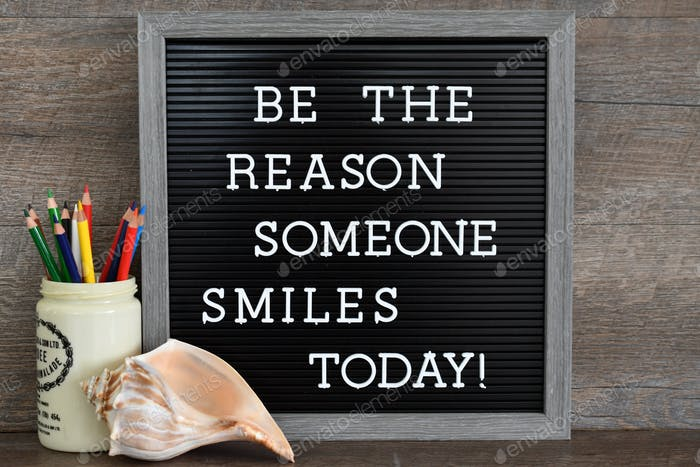 Be the Reason Someone Smiles Today message board sign with motivational quote.
