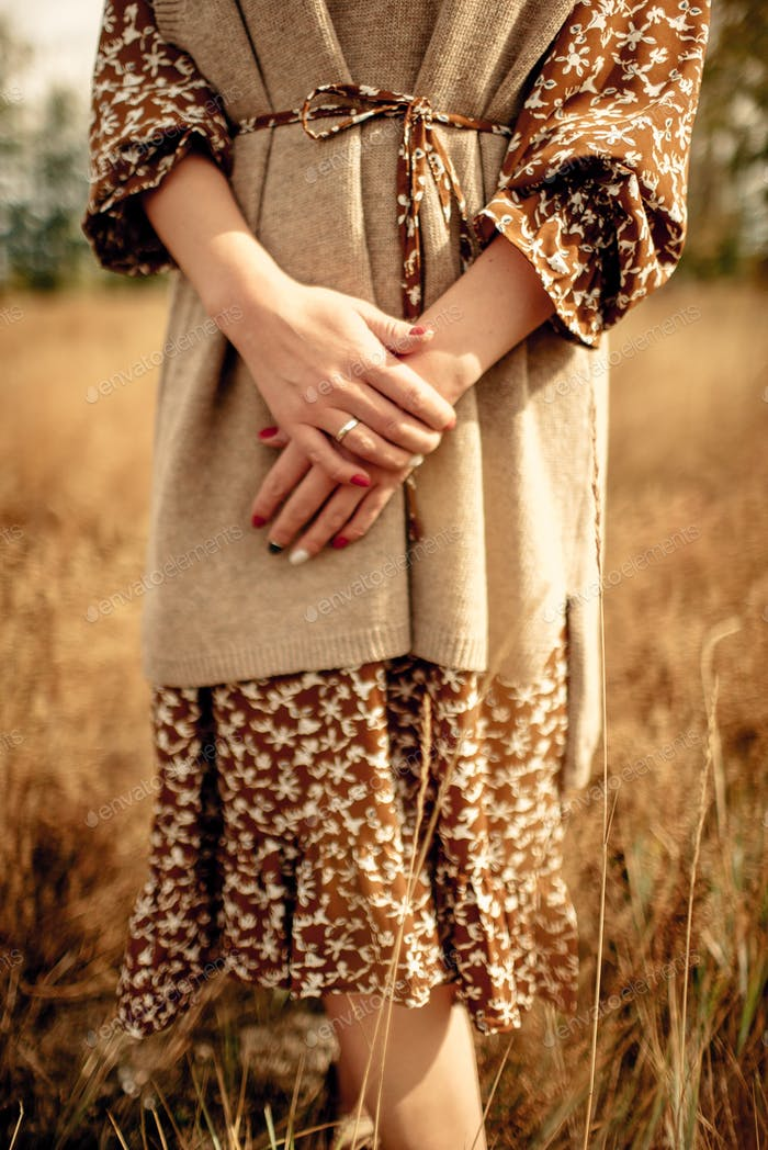a girl in the style of a boho at autumn