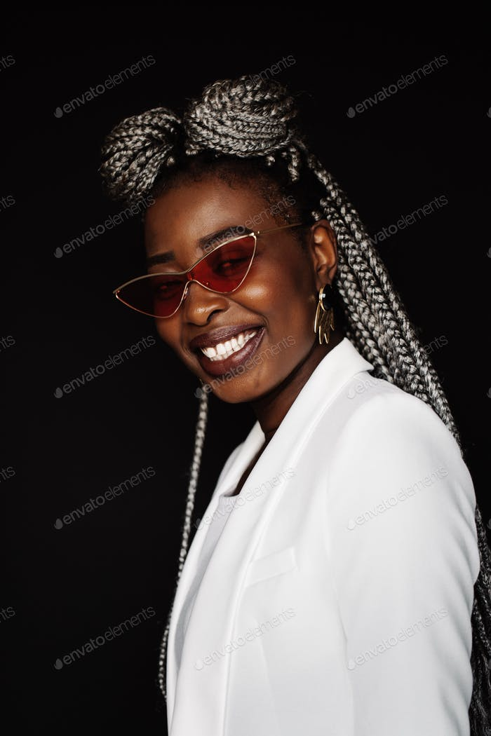 Young  black woman wearing sunglasses and smiling