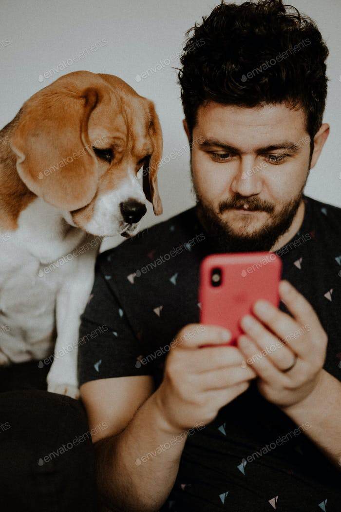Texting while dog is watching