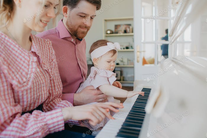 Family is playing piano