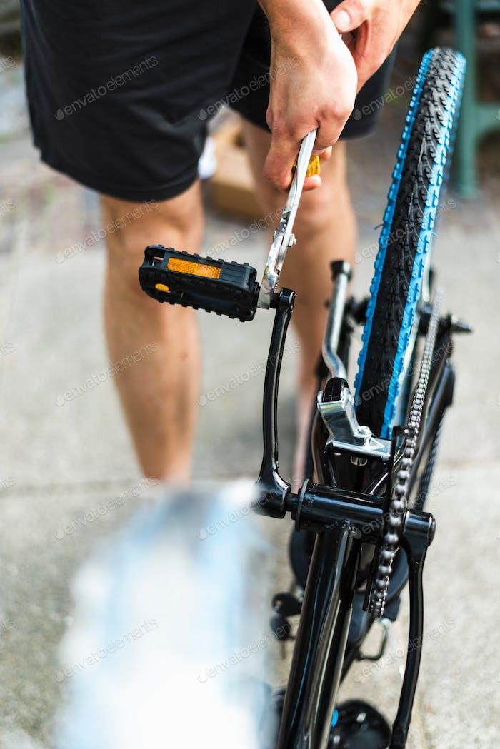 A man assemblies new bicycle.
