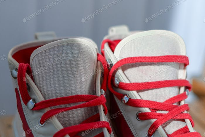 white sneakers with red laces