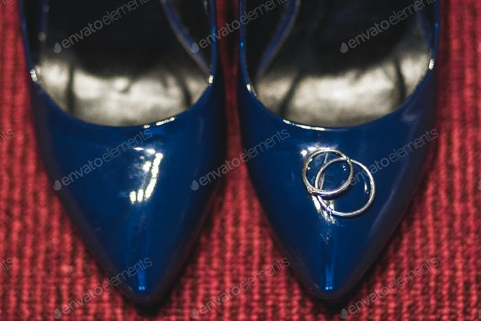 Engagement ring on a shoes