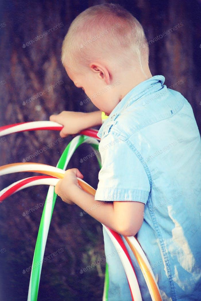 Boy with hula hoops