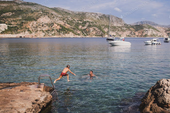 Boy jumping into the Adriatic Sea