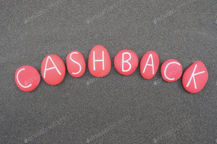 Cashback, reward program word composed with red colored stone letters over black sand