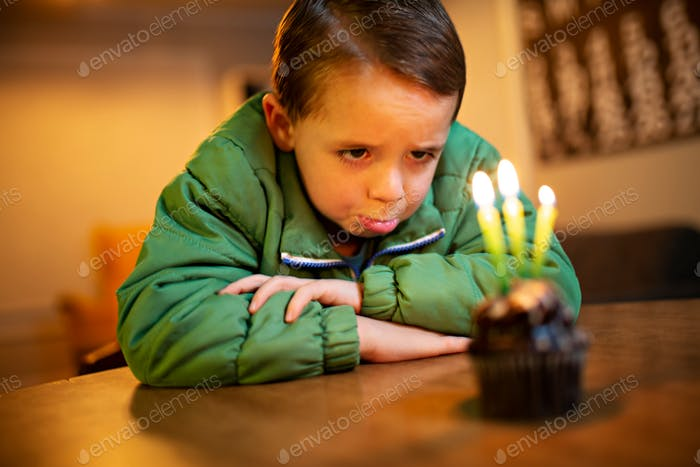 sad little boy crying because no one came to his birthday party
