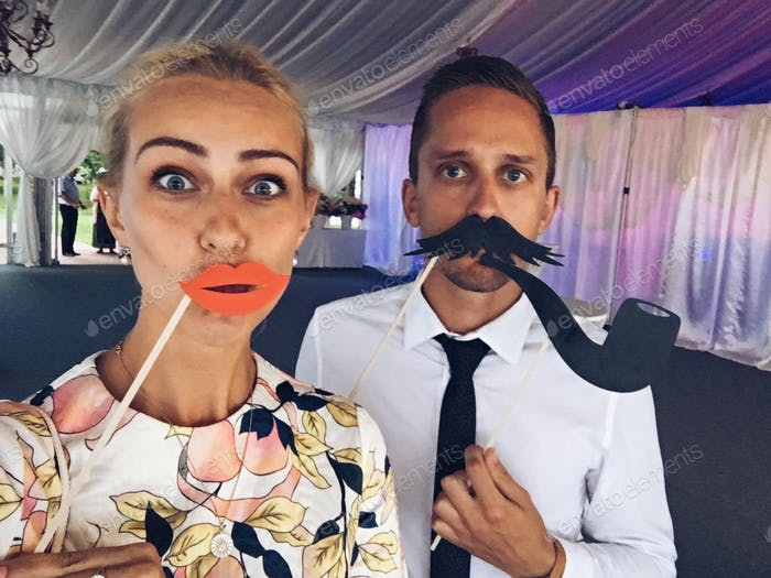Couple having fun at the wedding.