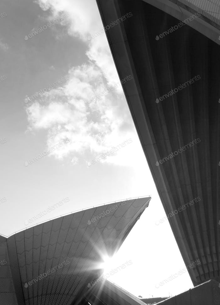 Afternoon sunlight shining between the 'sails' of the Sydney Opera House at sunset, Australia