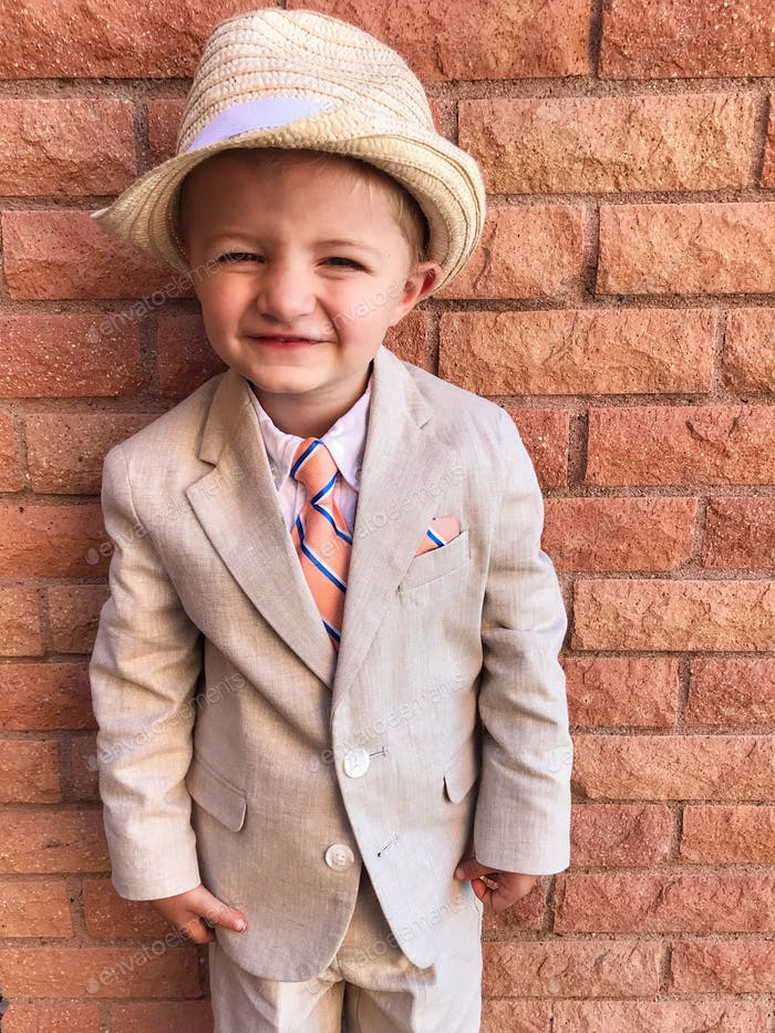Close up of little boy in formalwear with a big smile