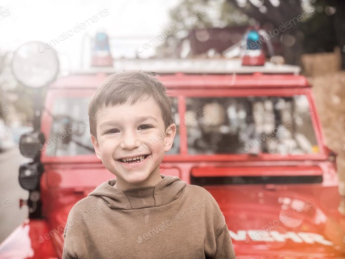 Happy Kid with a fire truck