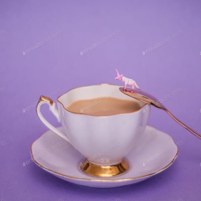 Miniature Origami unicorn with tea cup