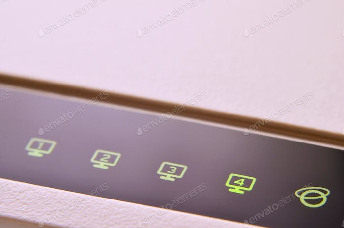 Closeup of internet router LED lights showing connection status