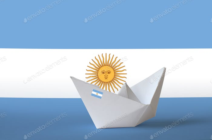 Argentina flag depicted on paper origami ship closeup. Oriental handmade arts concept