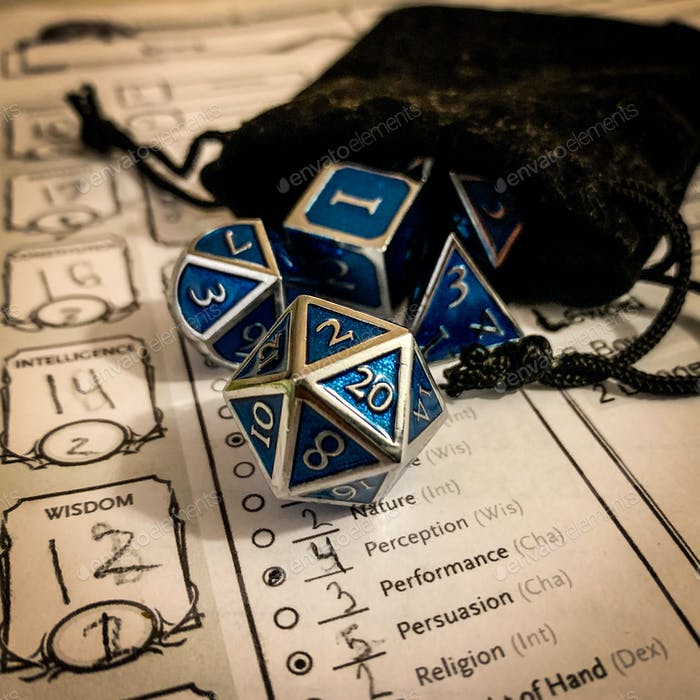 Dungeons and dragons dice and bag and character sheet