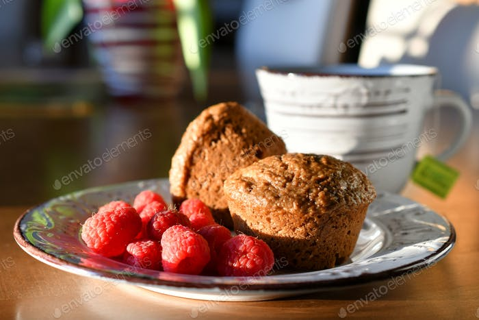 Bran muffins and raspberries with a mug of tea to start the day
