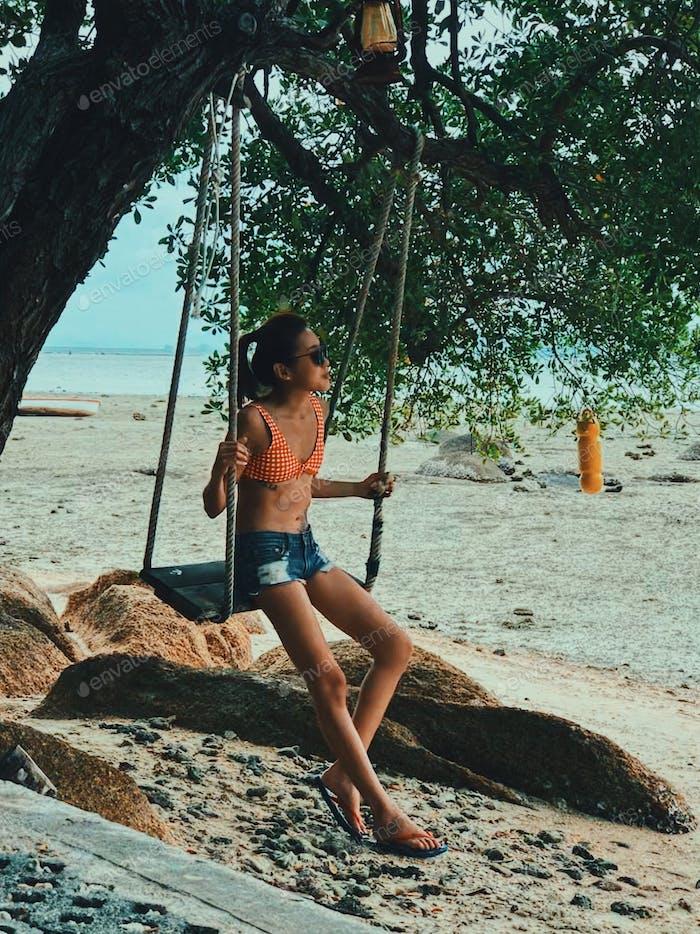 Woman on a swing.