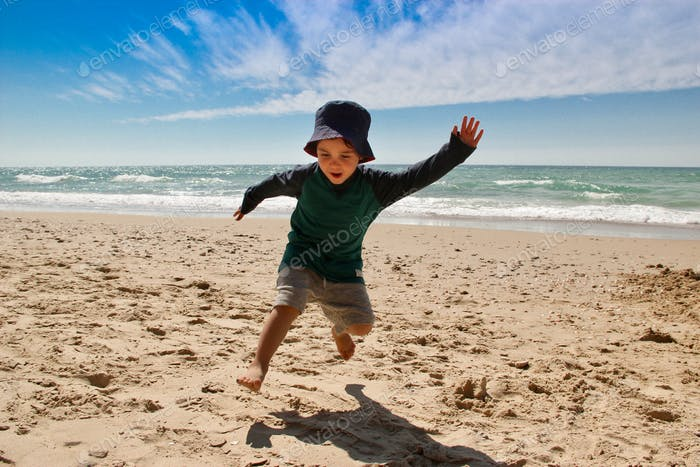 Happy kid at the beach