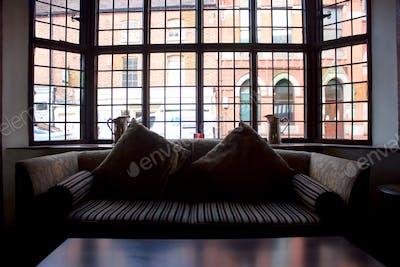 Window and empty sofa