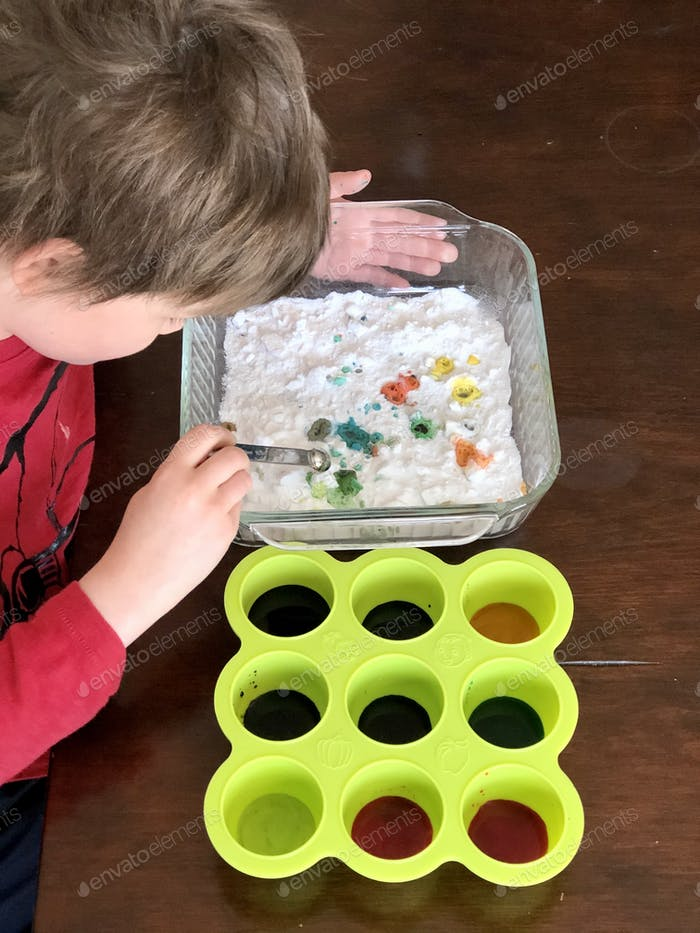 Child doing science experiment at homeschool
