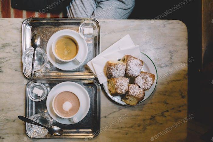 Hot coffee, hot chocolate drinks and cinnamon bun
