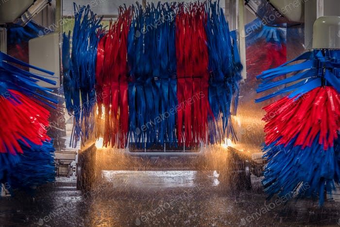 Brushes whirling in automated car wash