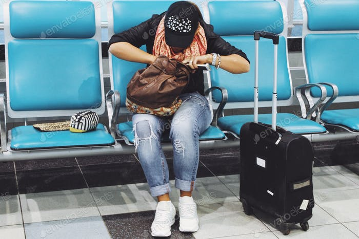 The woman waits for boarding at the airport
