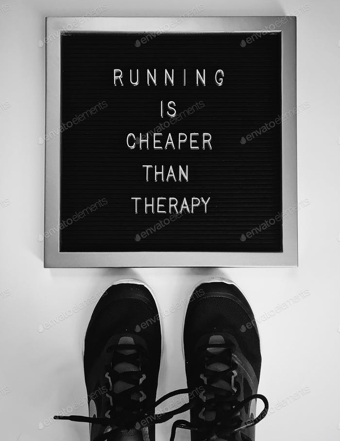 """Running is cheaper than therapy"" on letter board; running concept flat lay"