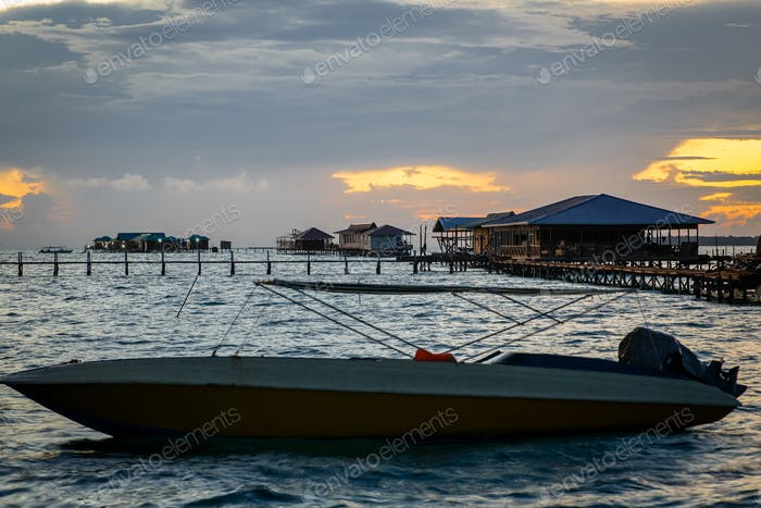 Water bungalows and chalets during sunrise in Semporna, Sabah.