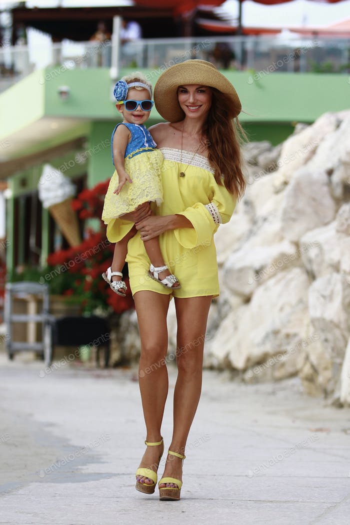 Mommy and daughter walking on the street