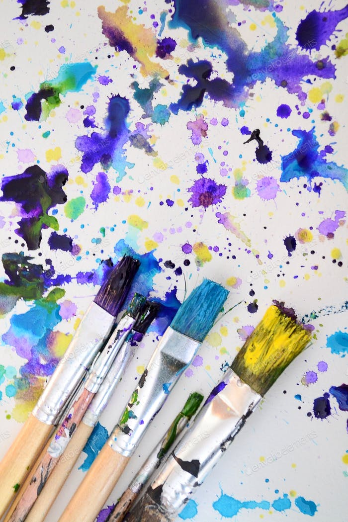 Watercolor stains and paintbrushes