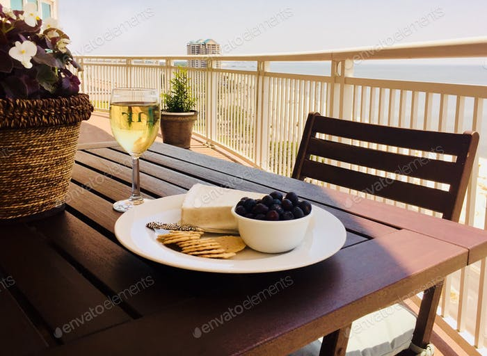 Light and Bright Lifestyle - wine and cheese on the balcony in late afternoon light