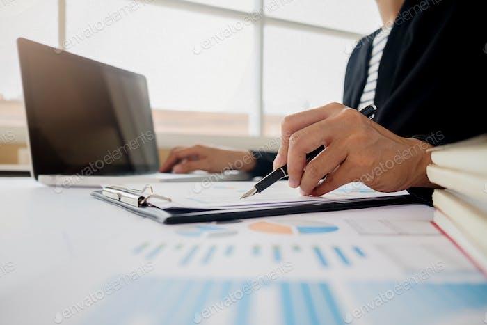 Business adviser analyzing financial figures denoting the progress Internal Revenue Service checking