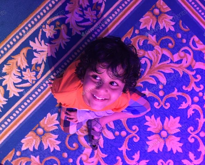 Happy kid at enchanted tales of Bella magic kingdom Disney Orlando Florida USA