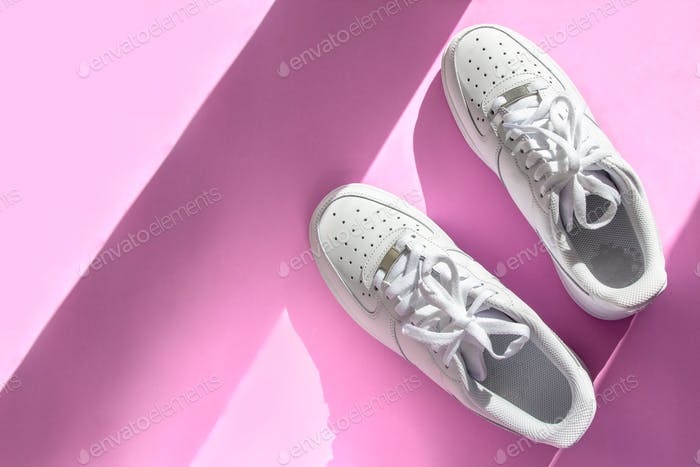 Fashion white sneakers on pink background