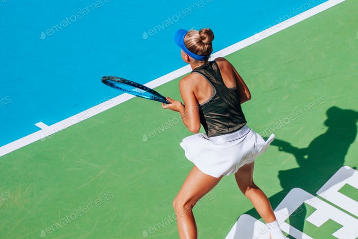 girl playing tennis, competitive sport, action shot