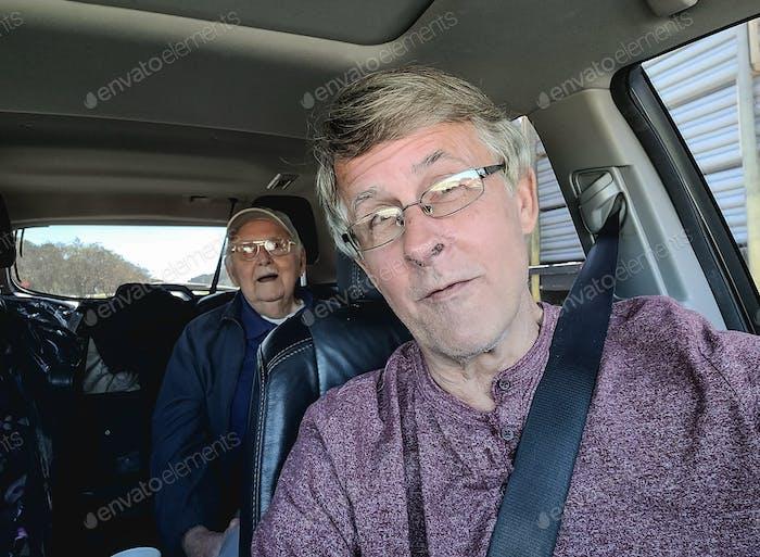 Running errands in car with senior citizen.