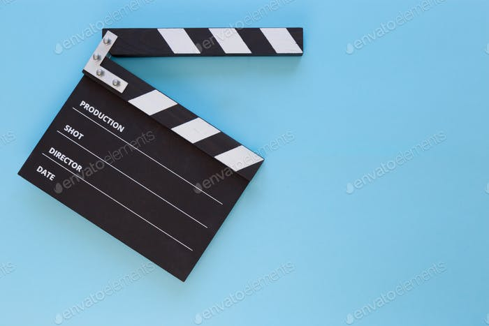 black Clapper board on blue background with free space for text