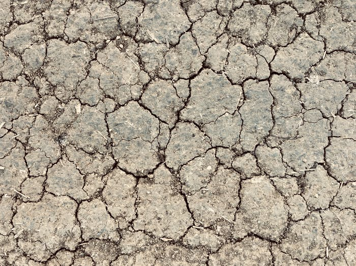 Dry cracked earth from drought for natural background
