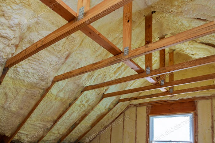Insulation of attic with foam insulation cold barrier and insulation material polyurea Spraying